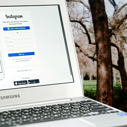 Samsung-laptop-on-instagram-login-page-with-park-in-background.jpg