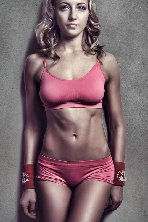 Attractive-Beautiful-Athletic-Woman-Wearing-Pink-Fitness-Clothing---Sexy-Female-Model.jpg