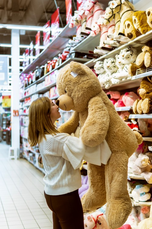 Woman-Carrying-Bear-Plush-Toy-Inside-Store.jpg
