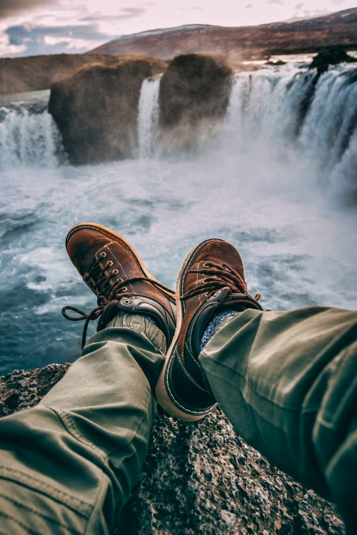 Person-Sitting-on-Rock-Near-Waterfalls.jpg
