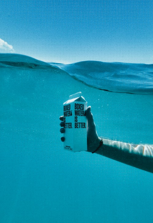 Blue-Underwater-Hand-Holding-Boxed-Water-is-Better.jpg